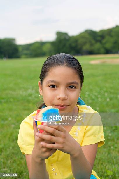 Girl in park with icy treat