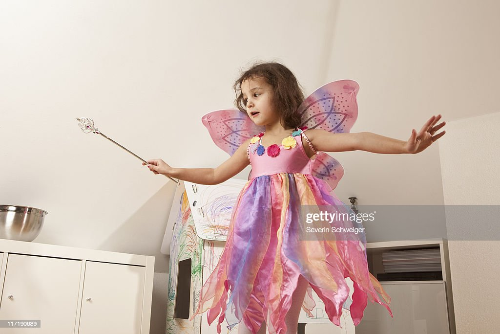 Girl in pink dress with fairy wings