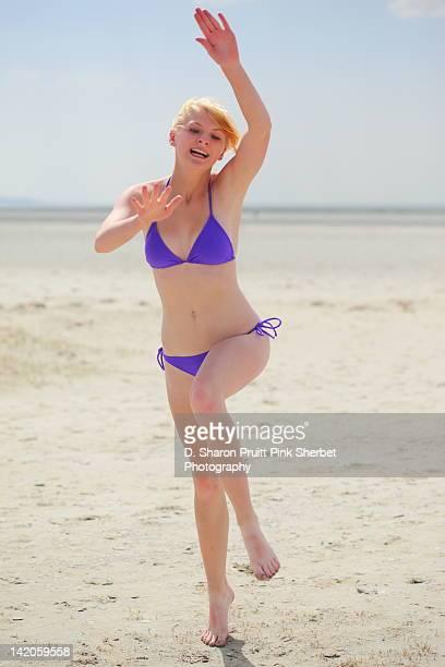 Girl in purple bikini