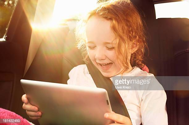 Girl (4 - 6 years) in rear seat of car