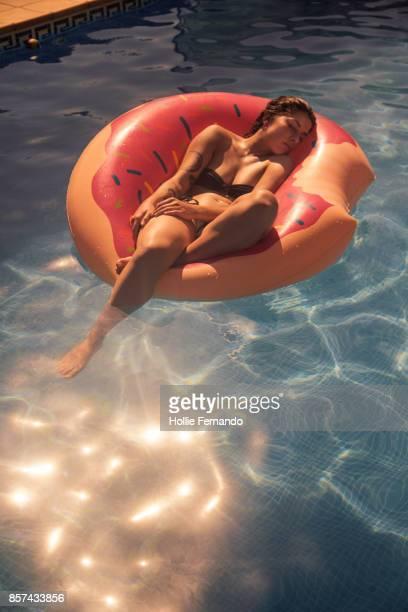 Girl in Rubber Ring in Swimming Pool
