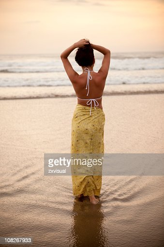 Girl in Sarong on Seminyak Beach in Bali