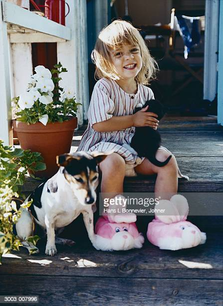 Girl in Slippers with Pets
