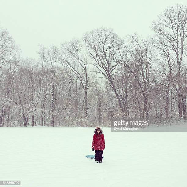 Girl in Snow with Sled