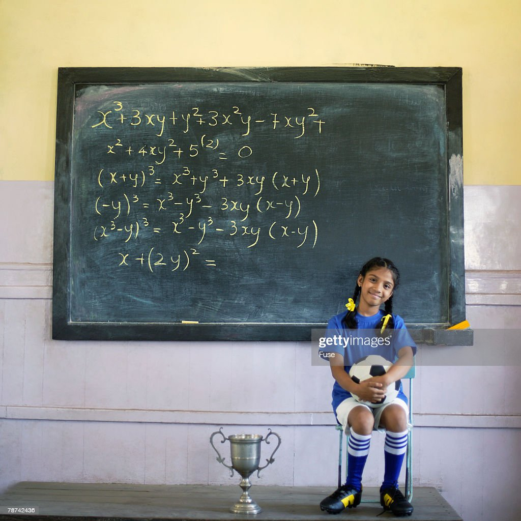 Girl in Soccer Uniform in Classroom