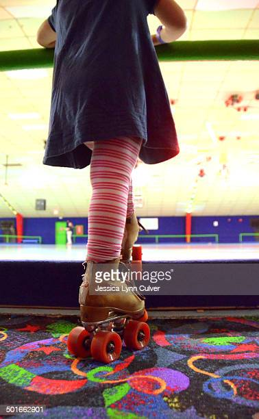 Girl in striped pants on roller skates