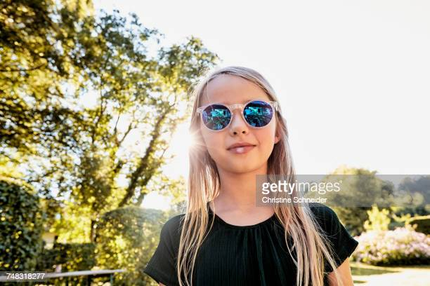 Girl in sunglasses enjoying sunny day