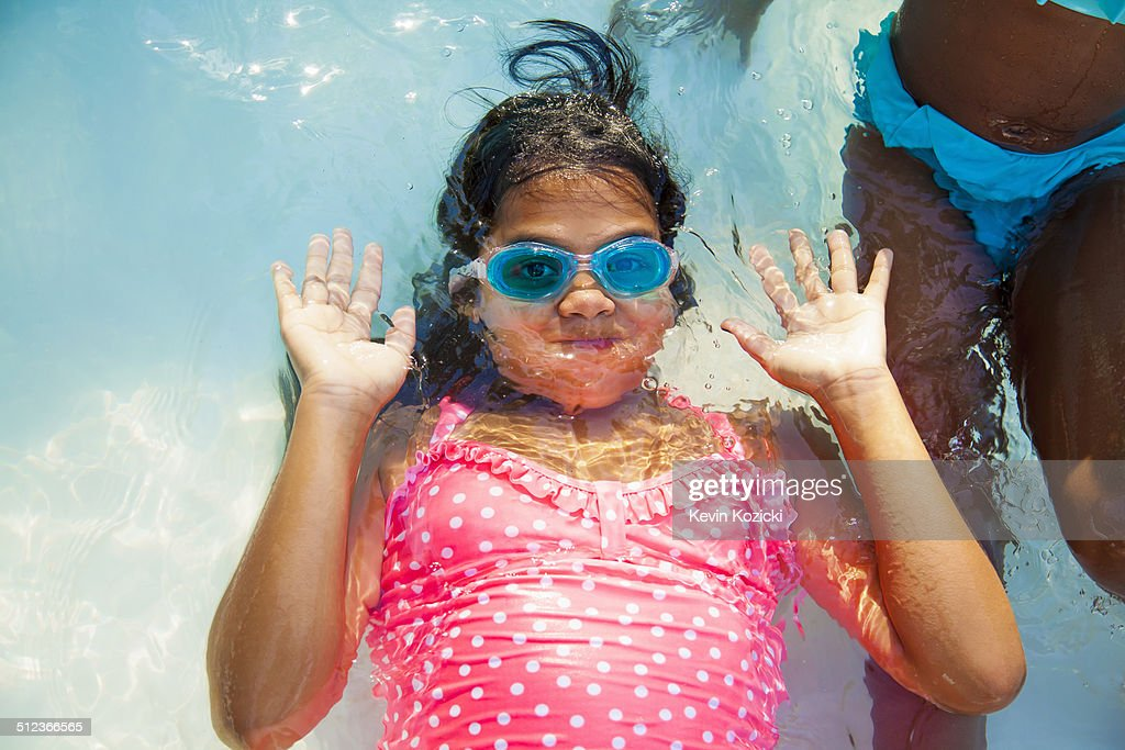Girl In Swimming Goggles Underwater In Garden Paddling Pool Stock Photo Getty Images