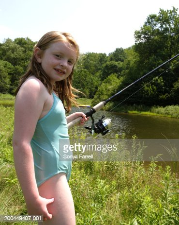 Little girl swimsuit stock photos and pictures getty images for Little girl fishing pole
