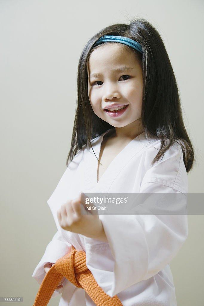 Girl (3-5) in Taekwondo uniform : Stock Photo
