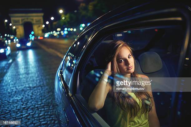 Girl in the car at Champs-Elysees, Paris, Fancce