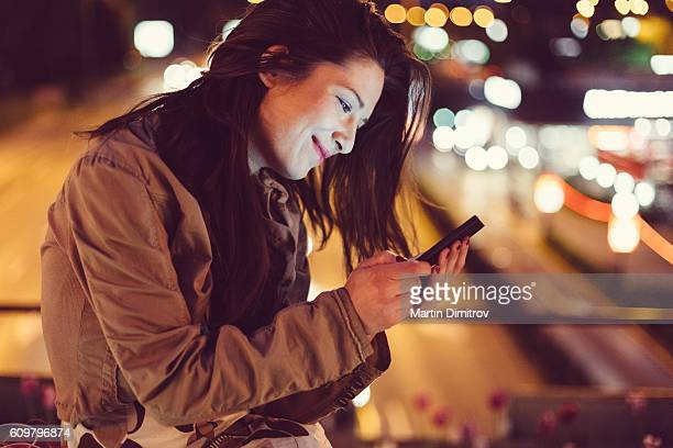 Girl in the city by night
