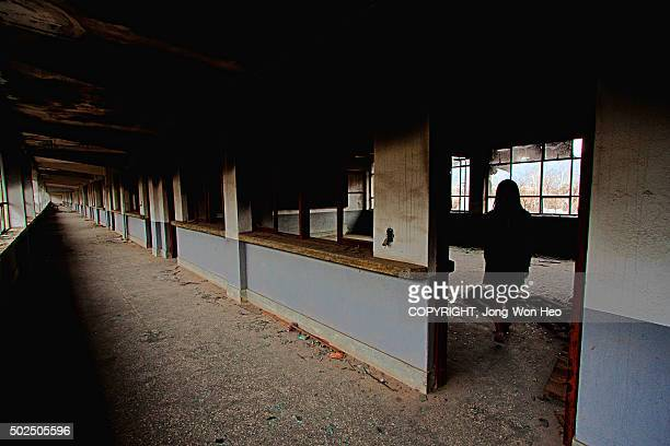 A girl in the empty classroom