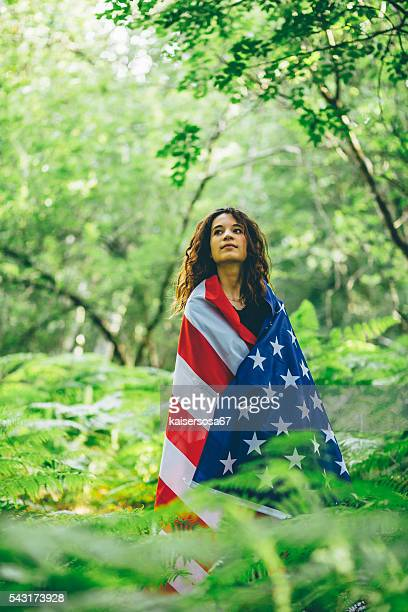 Girl in the forest with an American Flag