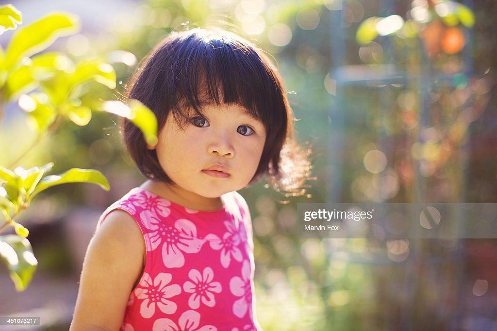 Girl in the garden : Stock Photo