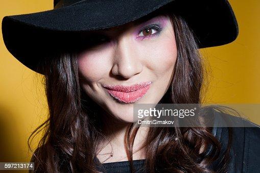 girl in the hat posing in the Studio : Photo