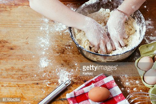 Girl in the kitchen playing with flour : Stock Photo