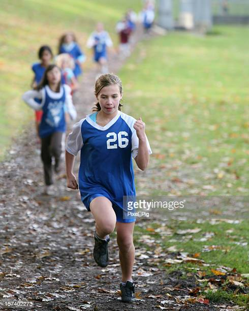Girl in the Lead at Cross Country Race