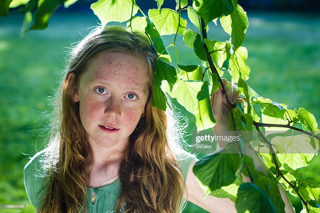Girl in the leaves : Stock Photo