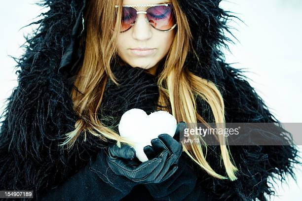 Girl in the snow holding a frozen heart