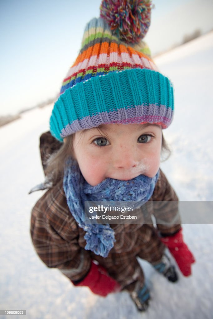 Girl in the snow : Stock Photo