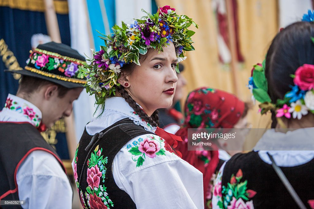 Girl in traditional polish costumes during the celebrations of the Corpus Christi, (Boze Cialo), in Lowicz, Poland, on May 26, 2016.