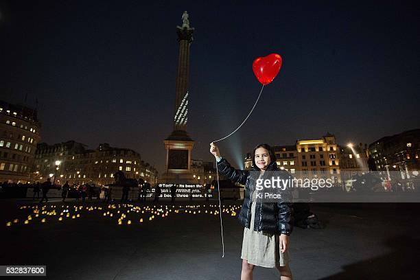 A girl in Trafalgar square mark s the 3rd anniversary of the Syrian crisis Save the Children Ambassador Dom Joly takes part in the #WithSyria...