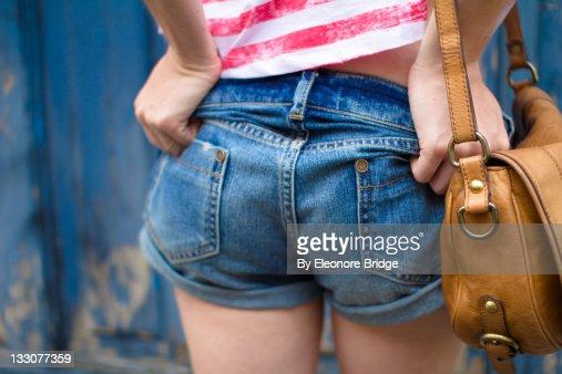 Girl in very short denim short