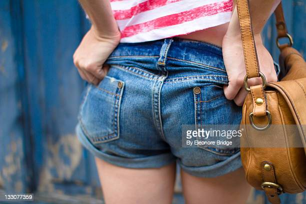 Girl in very short denim short