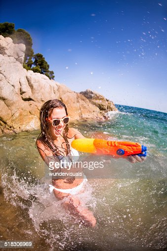 Girl In Waterfight At Beach