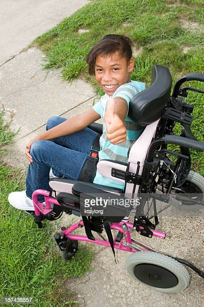 Girl in wheelchair gives thumb's up