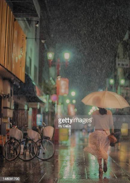 Girl in windy rain