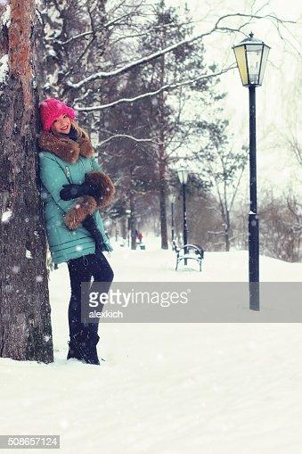 girl in winter street bench : Stock Photo