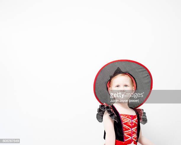 Girl in witch's costume