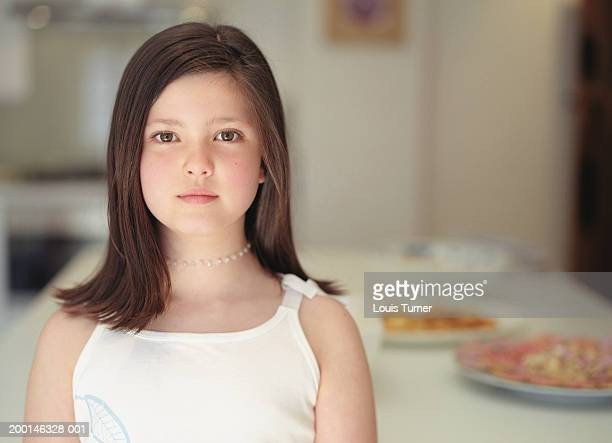 Girl (8-10) indoors, portrait