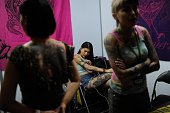 A girl inspects her tattoos during the Dutdutan Tattoo Festival on September 26 2015 in Manila Philippines The festival is the biggest tattoo...
