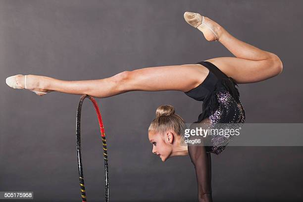 Girl is engaged in rhythmic gymnastics