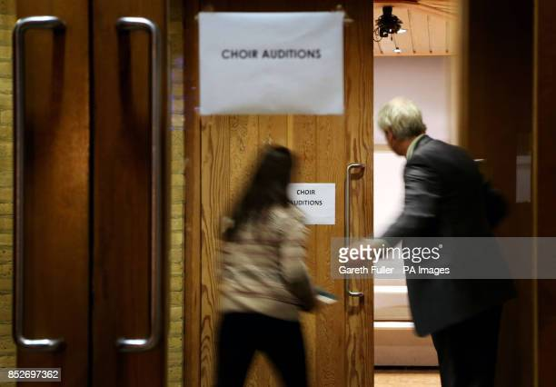 A girl is greeted into the audition room at Canterbury Cathedral Kent for the first girls' choir at the cathedral after more than 900 years of male...