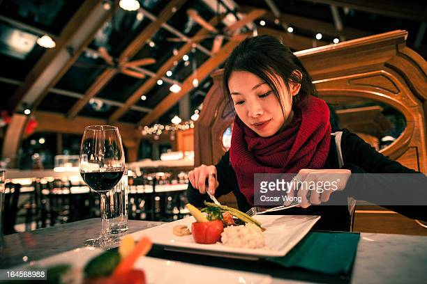 A girl is having meal in a western restaurant