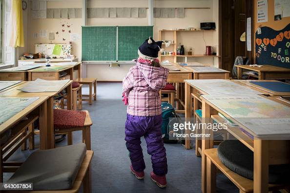 A girl is leaving an empty classroom Feature at a school in Goerlitz on February 03 2017 in Goerlitz Germany