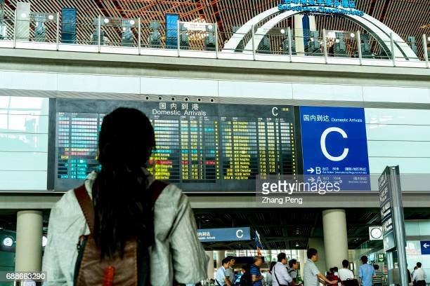A girl is looking at the flight arrival information board in Terminal 3 of Beijing Capital International Airport According to China CAAC China will...