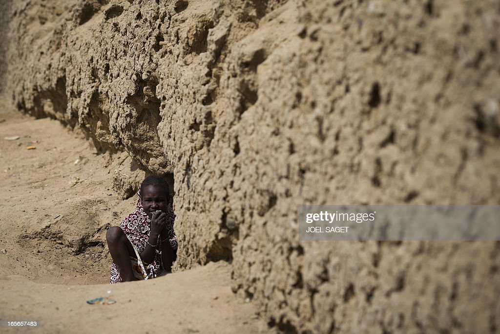 A girl is pictured in a street of Gao on April 5 2013 The United Nations expressed concern over reprisal attacks against ethnic Tuaregs and Arabs in...