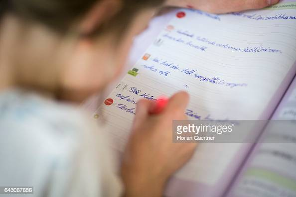 A girl is practicing writing Lesson at a school in Goerlitz on February 03 2017 in Goerlitz Germany