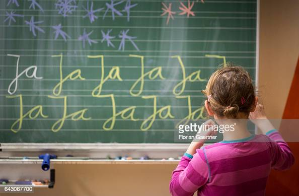 A girl is practicing writing on a blackboard Lesson at a school in Goerlitz on February 03 2017 in Goerlitz Germany