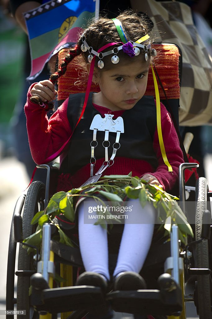 A girl is pushed on a wheelchair as thousands of Mapuches, Chile's largest indigenous group, participate in a protest rally in Santiago on October 15, 2012. Hundreds of indigenous Chileans and members of social organizations marched demanding the restitution of their ancestral lands -- just days after the 520th anniversary of Christopher Columbus' arrival in America. AFP PHOTO/Martin BERNETTI