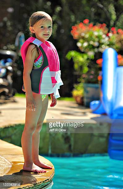 Girl is ready to jump in swimming pool