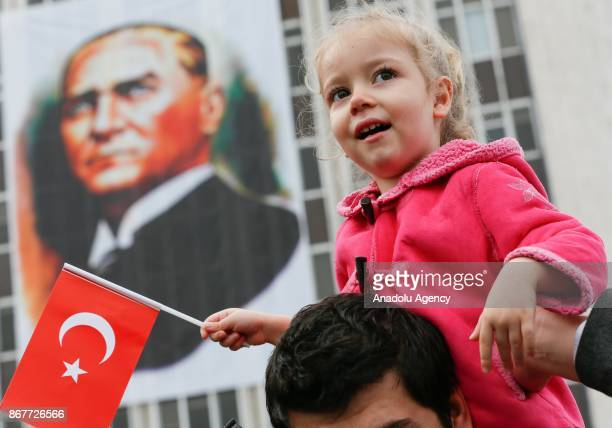 A girl is seen with a Turkish flag during the celebrations for the 94th Anniversary of Republic Day at the Izmir Cumhuriyet Square in Izmir Turkey on...
