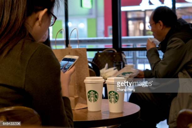 A girl is sharing Starbucks coffee images with her friends in social media In February Starbucks began a social gifting service 'Say it with...