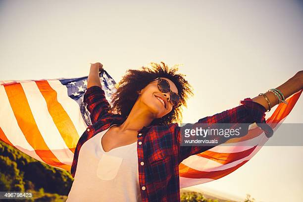 Girl is waving american flag