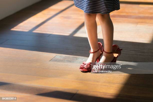 A girl is wearing too big women's shoes on August 07 2017 in Bonn Germany